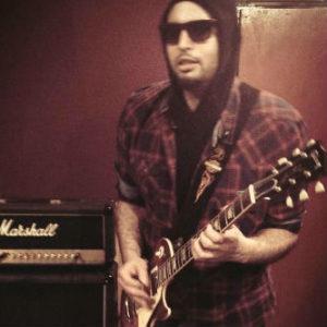 say - מורה לגיטרה